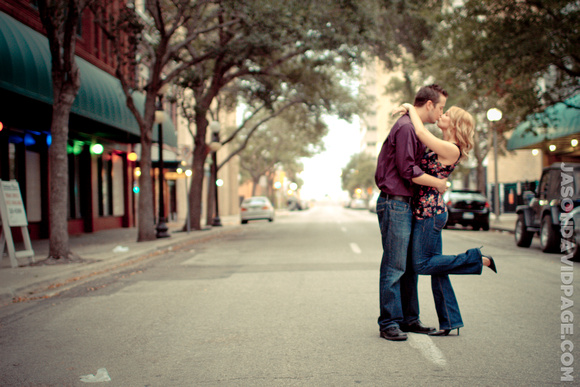 Couple sitting on Mesquite Street during downtown Corpus Christi engagement session