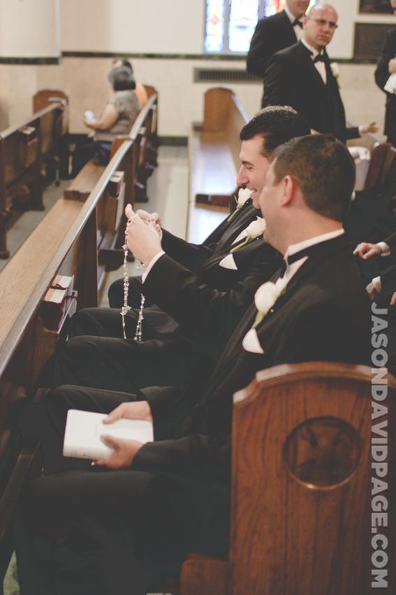 Groomsmen sitting in pew by Corpus Christi wedding photographer Jason Page