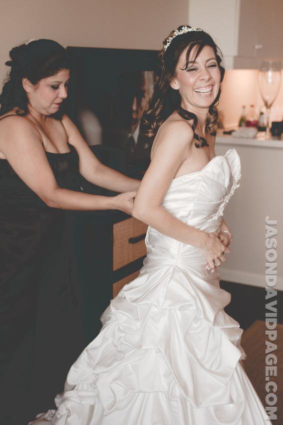 Getting in dress by Corpus Christi wedding photographer Jason Page