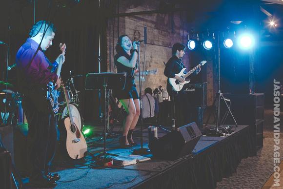 Clarissa Serna singing on stage by Corpus Christi wedding photographer Jason Page