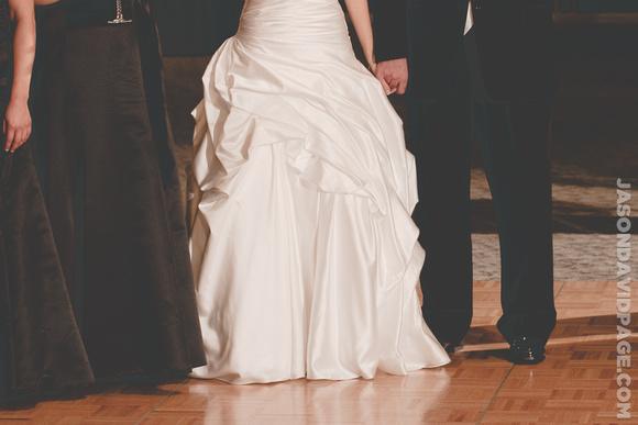 Jancie & Tim holding hands during toast by Corpus Christi wedding photographer Jason Page